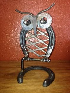 This adorable found object folk art owl is made from a shovel, circular saw blade, horse shoes and other recycled metal objects.