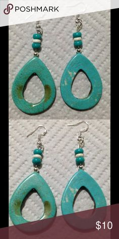 Turquoise Teardrop Earrings These beautiful earrings are made with large howlite teardrops. The accent beads on top are sterling silver and natural turquoise. The hooks are sterling silver. These earrings and all PeaceFrog jewelry items are made by me! PeaceFrog Jewelry Earrings
