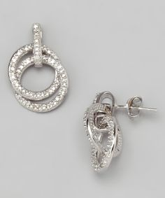 Slip on these double-circle studs and become the belle of the break room. Cherish the charm of brilliant diamonds and genuine sterling silver settings.0.25 minimum carat total weight diamond / sterling silverImported