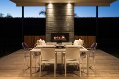 Focus on the flames with this full height concrete fireplace surround with spot feature lighting Stone Tile Fireplace, Outdoor Wood Fireplace, Fireplace Tile Surround, Outdoor Fireplaces, Fireplace Surrounds, Outdoor Seating Areas, Outdoor Rooms, Outdoor Living, Outdoor Range