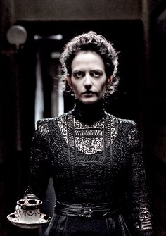 """Penny Dreadful"" - Vanessa Ives. She wears some gorgeous black dresses and coats. An incredible character."