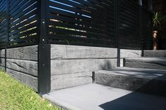 Timber look concrete sleepers and steel posts with steps from Aussie Concrete Products