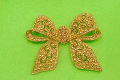 Ornate Gold Tone Bow Brooch with Topaz Rhinestone by Beadgarden55