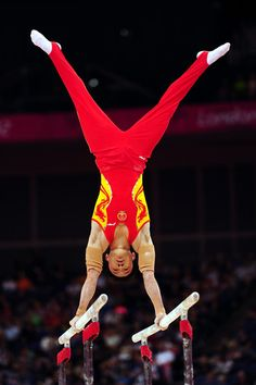 Weiyang Gao of China performs on the Artistic Gymnastics Men's Parallel Bars on day one of the London 2012 Olympic Games at North Greenwich Arena on July 28, 2012 in London, England.