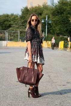 Take a look at this fashionista rocking oxblood at NYFW!  I love how she's worn this bold tone in a printed dress and gorgeous oxblood handbag and booties!