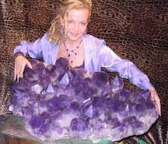A woman holds a very big piece of Amethyst. Just imagine how strong her immune system, joints, pituitary gland and hearing must be, if Amethyst could actually help those things!