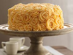 Peaches and Buttercream Cake - to get this effect, just use a star tip pastry bag and make circles!