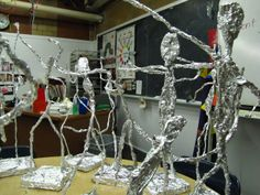 4th/ 5th: Giacometti inspired figure sculptures. Wire form in foam base, wrapped in aluminum foil, then plaster strips, painted black and then bronze to mimic the aged metal.