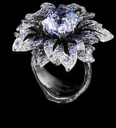 Jewellery Theatre: Jewellery Flowers Ring, 18K White and Black gold.  138 diamonds 0,87 ct, 1 aquamarin/topaz 10.50 ct, 253 blue sapphires 2,20 ct.