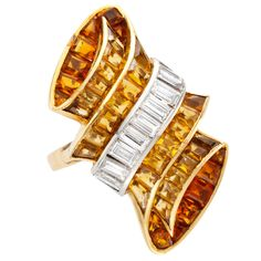 Rene Boivin, A Gold, Platinum, Citrine and Diamond Ring, designed  as  a scrolling  ribbon  set  with  calibré-cut  citrines,  and  baguette  diamonds  weighing  approximately  0.90  carat,  size  5½,  signed  Boivin,  Paris,  maker's  mark  for  Boivin,  French  assay  mark, circa 1935.
