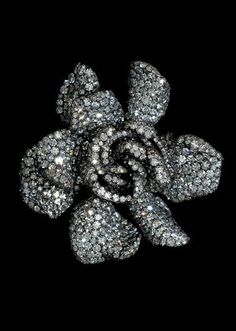 Modeconnect.com - A gardenia ring made of diamonds, silver and gold. Made by jeweler Joel A. Rosenthal of JAR