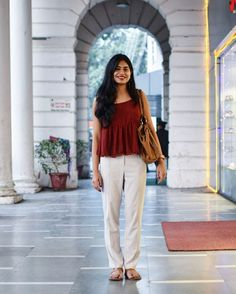 As cliched as it may sound, minimalism is not only about basics but how you wear your not-so-basic clothes in a way that they feel like second skin.  Spotted here-Maroon blouse, beige trousers with tan accents, sprinkled with festive happinees ✨  #streetstyledelhi #blog #Matargasht #fashion #delhi #ootd #lotd #potd #bestoftheday #womensfashion #fashionindia #streetfashion #streetstyle #minimalism #minimal