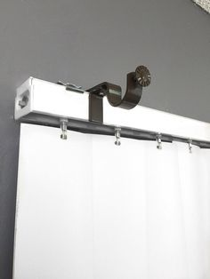 Easily hang curtains and dramatically change the look of any room by attaching this bracket to your outside mounted vertical blinds. Outside mounted vertical blind head rail attachment Fits up to 1 inch curtain rod No Brackets to screw in the wall No Drilling, No Hammering Set of 2