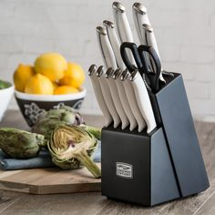 Wellington has a contemporary style with curved stainless steel and polymer handles; white handle is elegant and adds style to modern kitchens. Includes: 7.75 in. chef knife 8 in. bread knife 5 in. utility knife 3.5 in. parer 3 in. peeler Kitchen shears Six 4.5 in. tapered grind steak knives Wooden block Features: Dual Material Handle provides contemporary styling with curved stainless steel blade and polymer handles Forged design for increased weight and balance The white handle is elegant…