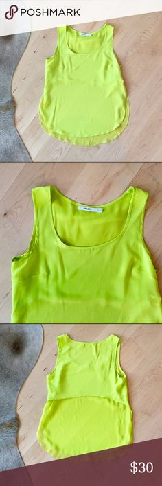 Bailey44 Sheer Back Top Bailey44 Sheer Back Top. This top is SO pretty! It's citron green (my favorite color as you might have guessed from my closet) 100% silk. The bottom portion of the back so sheer. The sides are open, but hang closed as shown in pic 4. So cute with white or blue jeans, or tucked into a high wasted pencil skirt. In like new perfect condition. Bailey 44 Tops Tank Tops
