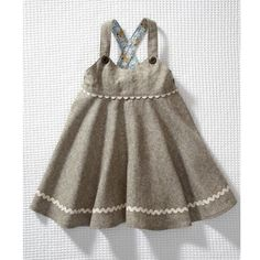 Can't get enough pinafore dresses, especially one with such sweet trimmings and details  [Olive's friend Pop via Style Milk]