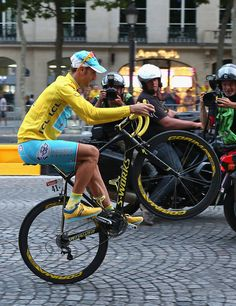 To This! Italy is so stoked! Italians REALLY love cycling and its because Vincenzo Nibali is this years TdF winner. He is also the first Italian to wear yellow on the Champs Elysees since Marco Pantani won in 1998 ( Pantani also won the Giro in 98 at the height of the doping era) and before that was Felice Gimondi in 1965. P.S. I dig those shoes!!! Congtatulations to The Shark!
