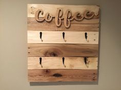 """This beautiful handmade coffee cup/mug rack holds up to 6 cups for easy and convenient storage giving your kitchen that rustic farmhouse look. COFFEE sign is a wooden cutout stained in a natural color with the rest of the rack stained in Puritan Pine with (2) coats of polyurethane There are (6) black matte finish hooks to hold your cups/mugs The dimensions are 18"""" Wide x 20"""" Tall x 2"""" Deep There are 2 heavy duty keyhole hangers on the back of the rack for easy and secure hanging Mounting ha Decor, Coffee Signs, Wooden Cutouts, Farmhouse Decor, Keyhole Hanger, Coffee Cup Rack, Mug Rack, Picture Mugs, Coffee Cups"""