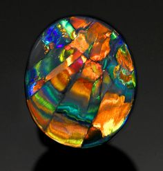 "Black Harlequin Opal ""The Cathedral Window"" - from Lightning Ridge, Australia. Look at it closely and you'll see every color of the rainbow!"