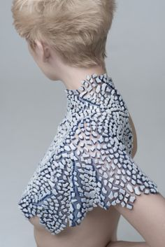 Innovative textiles for fashion with silicone fragments for a flexible textured fabric; conceptual fashion design