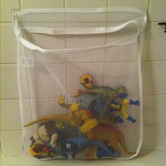 Homemade bath toy holder using a lingerie laundry bag and two 3m command hooks. Total cost, $4.70.