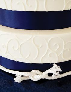 I love this cake, maybe not nautical theme but the wedding colors as your ribbon.