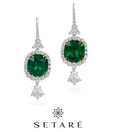These matched pair of 5 carat cushion cut emeralds posses exceptional vivid green saturation along with superb brilliance. Shield and trapeze cut diamonds are set to accentuate the vibrancy of the stones.