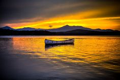 At Peace by Joe Martin - Amazing wall art for your home or office. This beautiful canoe  sets atop Silver Lake at sunset, with the silhouette of Mount Chocorua ~ New Hampshire, Click on the image to enlarge.