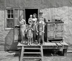 """All the Allens: 1937: """"Ray Allen family near Black River Falls, Wisconsin."""" The semi-crossed eyes of the center boy caught my attention first, then the oldest boy holding onto the young child. What an accomplishment it must have been to get those 6 rambunctious children in position for a picture !  Medium format negative by Russell Lee."""