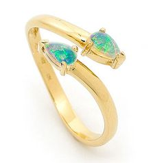 A sleek and modern opal gold ring design. Our in house designer selected pear shaped Australian Solid Light Opals sourced from quality opal mines in Coober Pedy, South Australia, and set them in 18k yellow gold.The smart simple design allows the wearer to adjust the ring to a variety of different sizes, therefore enabling the wearer to use the ring on different fingers and hands. #opalsaustralia