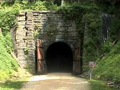 Tunnel #3 of the Elroy-Sparta bike trail.  It is the longest tunnel at 3/4 of a mile. Unlike the other 2 tunnels, you can't really see the opening at the other end of this tunnel until you go into it a little bit. This is also the wettest tunnel. You feel the cool air as you approach the tunnel and there are small streams on either side of the path (inside and outside of the tunnel) from the tunnel drainage...