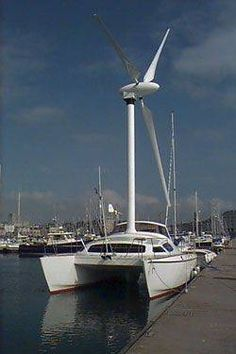 Someone was thinking outside of the box on this one. The 36 foot catamaran, Revelation II, is powered by 3 20-foot long carbon fiber propellers on a 30 foot rotating mast. The windmill transmits power to a 6 blade propeller underwater, with the net