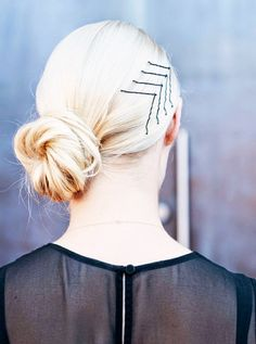 Spice up your low bun with a couple of well-placed bobby pins.