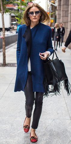 Olivia Palermo bundled up to brave the NYC cold in a teal coat that she layered over a basic white tee and leather pants. A fringed black carryall and studded leopard print loafer slippers rounded out her off-duty ensemble.