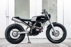 Fat Tracker: a chunky Yamaha TW200 from South African shop Wolf Moto.  XS250 tank