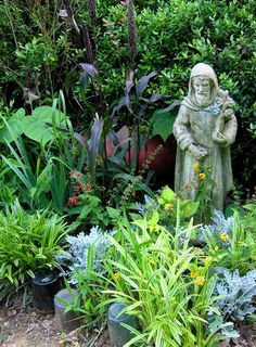Fiacre, patron saint of gardens. knew about St Francis for the animals, but had not heard of St Fiacre for the gardens! Bottle Garden, Garden Art, Beautiful Gardens, Garden Statues, Garden, Garden Borders, Wine Bottle Garden, Marian Garden, Seaside Garden