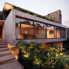 Mexico City house by JJRR/Arquitectura features sliding glass walls and verdant terraces | Dezeen | Bloglovin'