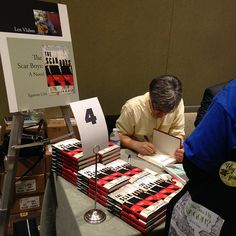 Len Vlahos signing The Scar Boys at the American Booksellers Association's Winter Institute 9 in Seattle, WA. January 2014.