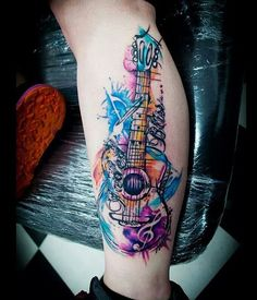 Watercolor styles are great to look at with the soft strokes and colors. Here's another watercolor tattoo design for music lovers.