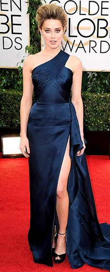 Amber Heard: 2014 Golden Globes The actress looked beautiful in a navy, one-shouldered Atelier Versace gown with a thigh high slit to reveal her toned body. She paired her look with Jimmy Choo stiletto sandals.