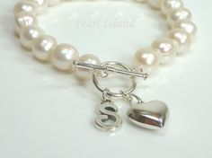 Personalised White Circle Pearl Bracelet with T-bar Clasp: www.pearlisland.co.uk