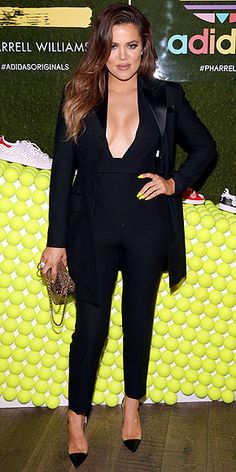 KHLOÉ KARDASHIAN Sure, there's lots of glam happening here (the plunging jumpsuit, the tailored jacket, the semi-translucent pumps and that metallic chain-strap bag), but we can't help but stare at Khloé's neon yellow mani! It adds such a playful vibe to her ensemble at the Pharrell Williams and Adidas celebration in L.A.