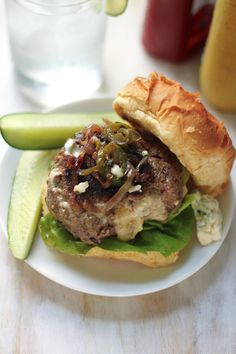 Blue Cheese Jucy Lucy Burgers with Caramelized Onions and Jalapeños