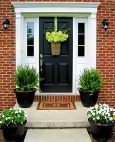 Have you ever wondered what your front door says about you and your home? Do you know how it influences your lifestyle? Find out how to implement the laws of feng shui in order to get the best out of the front door. The front door plays an. Front Door Planters, Front Door Porch, Front Door Entrance, Front Door Colors, Front Entrances, Front Door Decor, House Front, Porch Planter, Black Planters