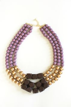 purple gold and brown wood bead statement piece