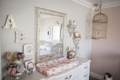 This bird cage adds an eclectic feel to this super-sweet shabby chic nursery!
