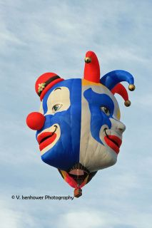 The blue and white faces on Triplet Crown -- the balloon with 3 clown faces.