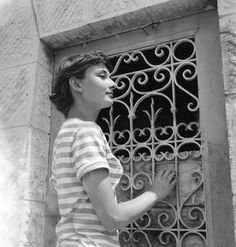 Audrey Hepburn photographed by Edward Quinn at the harbour of Monaco in 1951