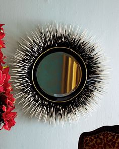 Porcupine Quill Mirror by Janice Minor at Neiman Marcus.Love these seven hundred dollar porcupine quills around a mirror.