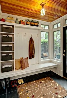 entry - shoes hidden under low bench instead of on front porch. Mirror in place of windows perhaps. or shopping list/ to do list chalk board